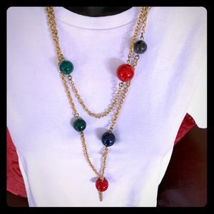 Gold tone chain necklace with bright colored balls